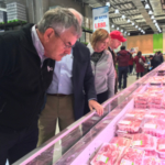 Lynn Chrisp (left), a corn farmer from Hastings, Nebraska, and first vice president of the National Corn Growers Association, examines a meat case in South Korea during a recent mission to celebrate South Korea's 45-year relationship with the U.S. Grains Council. (Courtesy of Nebraska Corn Growers Association)