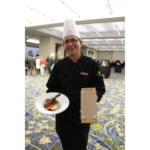"Andrew Ungs of Whiskey Road in Cedar Falls took top honors in the culinary contest at the Veterans' Memorial Community Choice Credit Union Convention Center. Chef Ungs prepared ""Peking Pork with Wasabi Mashed and Gingered Carrots"" and earned a plaque and $1,000 for his efforts. (Courtesy of IPPA)"