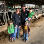 Steph and Josh Dahl are making changes to their 160-cow dairy operation that one day might benefit their children, twins Jaxie and Cashton, 4, and Bricker, 1. State Clean Water Fund and federal Environmental Quality Incentives Program grants covered about 90 percent of the cost to build a manure storage facility and calf barn. Previously, the dairy had only a few days' manure storage. In the winter, that sometimes meant repeatedly spreading on the flattest fields closest to the barn. The Dahl farm is part of a Root River Field to Stream Partnership, which will track what effect farmland conservation practices have on streams. (Courtesy of Minnesota Department of Agriculture)