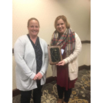 Stephanie Porter (right) of Burrus Seed, Arenzville, Ill., receives the CCA Soybean Master Adviser award from Jenny Mennenga, Illinois Soybean Association Production and Outreach Committee chair, at the 2018 ILSoyAdvisor Soybean Summit in Springfield, Ill. (Courtesy of Illinois Soybean Association)