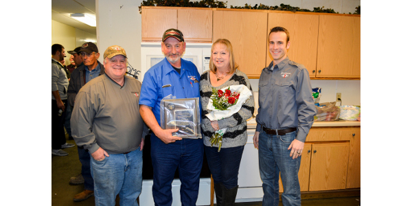 Bob Boatman, center left, and his wife, Ellen, are pictured with Jay Ludeman, left, Boatman's area sales manager, and Jerome Meyer, right, East Central/Select Sires general manager, after Boatman was recognized for achieving 200,000 A.I. services. (Courtesy of East Central/Select Sires)