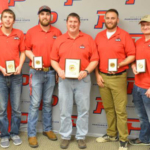 Agronomy team members flank their coach and instructor, Dr. Brad Ramsdale, after the Aggies of the Nebraska College of Technical Agriculture won first place in a contest Saturday at Goodwell, Oklahoma. They had the top four individuals, as well. From left, Jacob Valley, Plattsmouth; Lee Jespersen, Hemingford, tied for 3rd; Will Kusant, Comstock, 2nd; Coach Ramsdale with 1st place team plaque; Nate Montanez, Grand Island, 3rd tie; Dalon Koubek, North Platte, 1st place; and Catherine Ljunggren, Harvard. (Brent Thomas/NCTA News Photo)