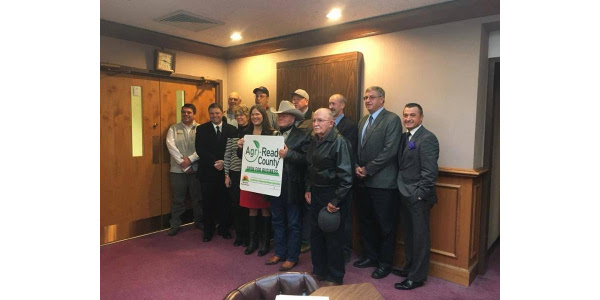 The Cape Girardeau County Commission is joined by Cape County farmers, ranchers and local leaders on Dec. 14, 2017 at the Cape Girardeau County Administrative Offices as the Commission formally applies to become an Agri-Ready Designated County. Back row (L to R): Rick Aufdenberg, Joe Hobbs, Cape County Farm Bureau President Kenny Spooler, Commissioner Charlie Herbst, Commissioner Paul Keoper, Jackson Chamber of Commerce Executive Director Brian Gerau. Front row (L to R): Matt Bain, southeast regional coordinator for the Missouri Farm Bureau Federation, Presiding Commissioner Clint Tracy, Debbie Birk, Missouri Farmers Care Executive Director Ashley McCarty, Larry Miller and Dale Steffens. (Photo credit: Patty Miller)