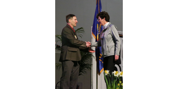"""Mary Elvekrog, representing Compeer Financial, is recognized as first Vision Sponsor at PDPW Business Conference on Mar. 14, 2018 in Madison, Wis."" (Courtesy of PDPW)"