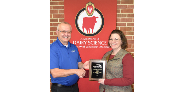 Dr. Heather White, Assistant Professor of Nutritional Physiology at UW-Madison, accepts the AgSource 2018 Friend of the Cooperative Award from COO, Pat Baier.