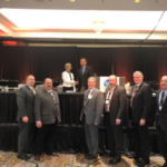 IPPA Board members pose for a picture as retiring NPPC President, Ken Maschhoff recognizes Jill Appell for being inducted into the National Pork Producers Council Hall of Fame. Appell has dedicated countless years to the Illinois Pork Producers Association and to NPPC. (From left: Jason Probst, Curt Zehr, Jill Appell, Ken Maschhoff, Mike Haag, Dereke Dunkirk, Phil Borgic, and Dale Weitekamp.) (Courtesy of Illinois Pork Producers Association)