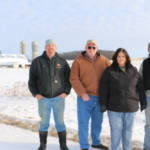 The Rosen family on their farm near Emerald this winter, from left, Dan, Dennis, Deb and Dave Rosen. (Courtesy of Wisconsin Farmers Union)