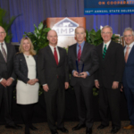 MMPA President Ken Nobis (left) and General Manager Joe Diglio (right) presented the Valued Partner award to Leprino Food Company. Accepting the award from Leprino Foods were (center, L-R) Associate Director of Raw Dairy Ingredient Sales Melissa Bischoff, Vice President of Supply Chain Mark Benson, CEO Mike Durkin and Senior Vice President of Corporate Affairs Mike Reidy. (Courtesy of Michigan Milk Producers Association)