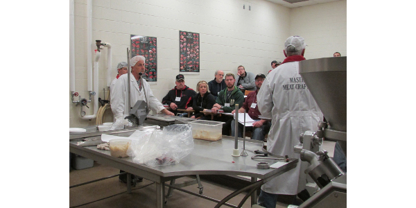 A sausage-making demonstration at the 2015 Wisconsin-Minnesota Meat Processing School. (Courtesy of UW-River Falls)