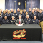 Kentucky soybean farmer-leaders and staff surrounded Ag Commissioner Ryan Quarles as he signed the document proclaiming the week of March 5 as Soybean Week in Kentucky. (Photos by Rae Wagoner, Kentucky Soybean Staff)