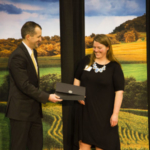 Iowa Secretary of Agriculture Mike Naig presented Sarah with the Leadership in Conservation Award during an awards ceremony and dinner on March 6, with U.S. Secretary of Agriculture Sonny Perdue in attendance. (Courtesy of Practical Farmers of Iowa)