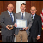 Provost David Blackwell, left, and President Eli Capilouto, right, presented Roger Brown, with an outstanding teaching award. (Courtesy of University of Kentucky)
