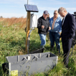 Iowa farmer Nick Meier speaks to Agriculture Secretary Tom Vilsack and La Porte City, IA Mayor David Neil about the saturated buffer conservation practice near a local stream on Meier's farm in La Porte, IA on Friday, Oct. 16, 2015. (USDA photo by Jason Johnson via Flickr)