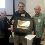 Dennis Fulbright (middle) receiving the Chestnut Pioneer Award from Roger Blackwell (left), president of Chestnut Growers Inc., Josh Springer (right), and Midwest Nut Producers Council president. (Courtesy of MSU Extension)