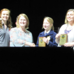Photo L to R: Council members Ashlynn Lingle and Caitlin Remington present the awards to Central DeWitt student, Heather Cernek, and teacher, Amy Grantz. (Courtesy of Iowa Agriculture Literacy Foundation)