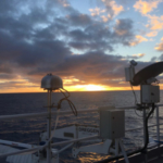 Aerosol filter samplers at sunset on the Australian Marine National Facility (MNF) research vessel, R/V Investigator. (Photo by Kathryn Moore)