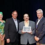 DFA's state-of-the-art ingredients plant in Garden City, Kan., recently received the Sustainable Plant of the Year Award from Food Engineering magazine. Pictured from left to right at the award presentation: Debra Schug, Editor in Chief, Food Engineering Magazine; Rusty Golliher, Vice President of Engineering, DFA; Jeff Johns, Senior Vice President, Shambaugh & Son; Nathan McFerrin, Director of Project Engineering, DFA. (Courtesy of DFA)