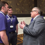 From left, Center for Risk Management Education and Research (CRMER) Student Fellows Jeff Hadachek, senior in agricultural economics, and Coleman Forst, senior in finance and agricultural economics, speak with USDA Under Secretary William Northey at the recent K-State-CFTC conference in Overland Park, Kansas. (Courtesy of K-State Research and Extension)