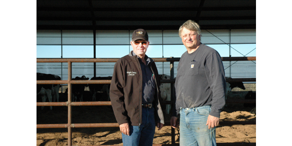 University of Missouri Extension specialist Ted Probert, left, says compost-bedded pack barns provide many benefits for dairy cows. Dwight Fry, right, says one of the benefits has been reduced somatic cell counts, an indicator of higher milk quality. (Photo credit: Photo by Linda Geist)