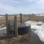 Water development projects such as this water tank can help ensure that livestock have access to good-quality water throughout the grazing season. (NDSU photo)