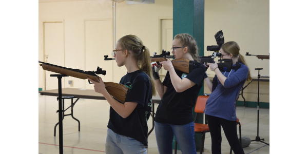 Cass County air rifle team members (from left) Rebecca Van Vleet, Mercedes Francis and Lillian Roth take aim at the 4-H State Air Rifle Match in Devils Lake. (NDSU photo)