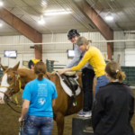 Adapted therapeutic riding lessons help people with physical, cognitive, emotional, behavioral or mental health challenges improve their motor skills, self-confidence, strength and independence. (NDSU photo)