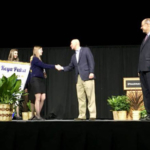 Governor Ricketts congratulates a FFA student at Thursday's convention. (Courtesy of Office of Governor Pete Ricketts)