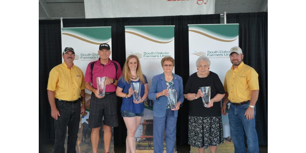 2018 nominations for the Rural Dakota Pride awards are due July 1. To nominate a volunteer in your community, simply visit the SDFU website, sdfufoundation.org or contact Hofhenke at 605-352-6761 ext. 114. The five Rural Dakota Pride Awards will be presented during SDFU Day at the 2018 South Dakota State Fair. 2017 honorees are pictured here: The honorees are pictured here with SDFU Vice President, Wayne Soren, (far left ) and SDFU President, Doug Sombke. Honorees include (left to right): Bob Satter, Irene; Lacey Rippentrop, Tea; Donna Duffy, Winner; Lorelee Nelson, Carthage and Jeff Kreun, Black Hawk (not pictured). (Courtesy of SDFU)