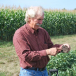 David Clay, SDSU Professor in the Agronomy, Horticulture and Plant Science Department, encourages South Dakota soybean farmers to join the South Dakota Soybean On-Farm Research website. A collaborative effort between The South Dakota Soybean Research and Promotion Council (SDSRPC), SDSU Extension and the South Dakota Agricultural Experiment Station at SDSU, the On-Farm Research website is designed so farmers can easily share on-farm research data and navigate local test results. (Courtesy of SDSRPC)