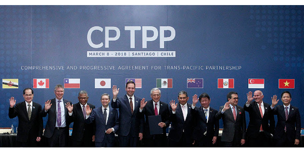 (L-R) Singapore's Minister for Trade and Industry Lim Hng Kiang, New Zealand's Minister for Trade and Export Growth David Parker, Malaysia's Minister for Trade and Industry Datuk J. Jayasiri, Canada's International Trade Minister Francois-Phillippe Champagne, Australia's Trade Minister Steven Ciobo, Chile's Foreign Minister Heraldo Munoz, Brunei's Acting Minister for Foreign Affairs Erywan Dato Pehin, Japan's Minister of Economic Revitalization Toshimitsu Motegi, Mexico's Secretary of Economy Ildefonso Guajardo Villarreal, Peru's Minister of Foreign Trade and Tourism Eduardo Ferreyros Kuppers and Vietnam's Industry and Trade Minister Tran Tuan Anh pose for an official picture after signing the rebranded 11-nation Pacific trade pact Comprehensive and Progressive Agreement for Trans-Pacific Partnership (CPTPP) in Santiago, on March 8, 2018.A slimmed-down trade pact signed on Thursday will allow eleven Asia-Pacific nations to push forward with economic integration in the face of greater US protectionism, even if the new deal will offer less benefits than originally hoped. / AFP PHOTO / CLAUDIO REYES