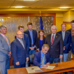 Kansas Agribusiness Retailers Association's (KARA) office near downtown Topeka hosted Governor Dr. Jeff Colyer Saturday afternoon as he inked his signature onto House Bill 2280, which revises the Rules and Regulations Filing Act pertaining to economic impact statements. (Courtesy of KARA)