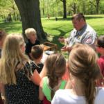Dalton Gatton, Natural Resource Specialist with Lake Shelbyville Army Corp of Engineers teaches students which snakes are native to Illinois at Christian County Conservation Day. (Courtesy of University of Illinois Extension)