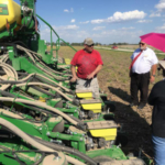 A group of Vietnamese grain buyers visited Missouri last week with the Missouri Department of Agriculture. The group visited Schutte Brothers Farms in Laddonia where Missouri Corn board member Jay Schutte discussed the farm's practices and gave the group a firsthand look at planting. (Photo Credit: Missouri Corn Merchandising Council)