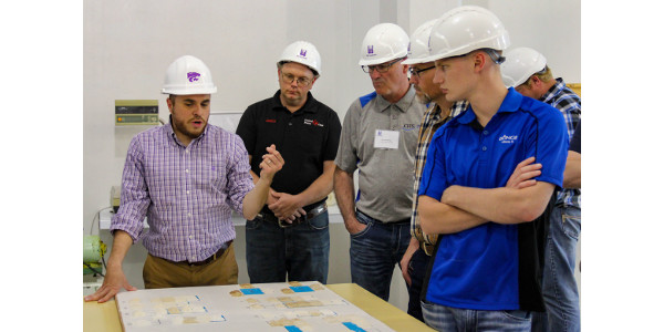 Carlos Campabadal, feed manufacturing and grain quality management curriculum manager, explains to participants different grain consistencies for Grain Elevator Management course participants. Shown left to right are Tom Phillips, Kansas State University; John Kuhlman, CHS United Plains Ag; Scott Endriss, NEW Cooperative Inc.; and Kendall Frahm, Bunge North America. (Courtesy of KSU-IGP Institute)