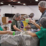 Volunteers in action at the Livingston, McLean & Woodford County Meal Packaging Event this spring where they packaged over 20,000 food servings to donate to local area food banks to help feed our communities. (University of Illinois Extension)