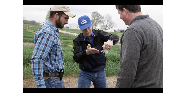 (L-R) Josh Duckworth, Tim Stombaugh and Carl Bradley discuss nozzle spray angles. (Photo: Dave Stalion)