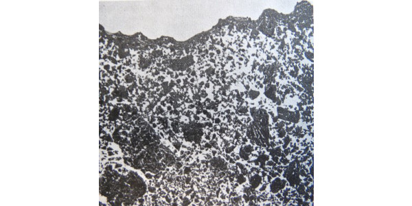 Photo 1. Microphotograph showing a very thin crust on a fine-textured soil. The white space in the photo represents the pores in the soil. (Source: MSU Extension Bulletin E-1460, Compact Soil – Visual Symptoms)