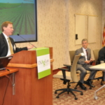 Gary Chapman, attorney from Bose McKinney and Evans speaks at a previous event. Seated in middle is Dan Gordon, attorney, Gordon & Associates. On end is Ken Roney, attorney, Indiana Farm Bureau Insurance. (Courtesy of Indiana Farm Bureau)