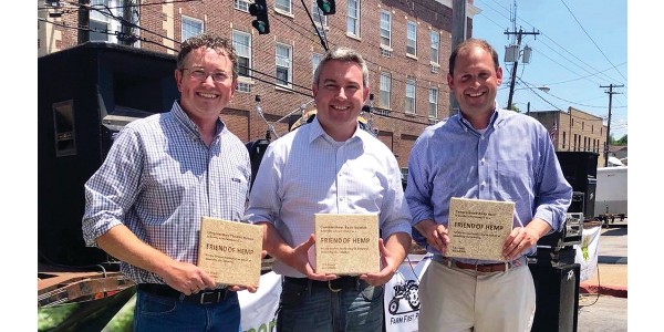 "The U.S. Hemp Roundtable, the hemp industry's leading national business association, presented Kentucky Commissioner of Agriculture Ryan Quarles, Rep. Andy Barr, and Rep. Thomas Massie with ""Friend of Hemp"" Awards for leadership on behalf of the industry. (Kentucky Department of Agriculture photo)"