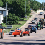 Farmers driving tractors on Minnesota Avenue in Sioux Falls. (Courtesy of South Dakota Corn Growers Association)