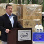 Ackerman recently joined Kentucky agriculture commissioner Ryan Quarles and dairy industry representatives in Winchester at one of the God's Pantry distribution centers to announce steps being taken to help improve the flow of milk to needy families. (Courtesy of Farmstead Media)