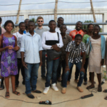Scott Massey (center, with sunglasses), a founder of Heliponix LLC, poses with residents of Togo who took part in a hands-on workshop on hydroponics in the small West Africa country, where many people survive on subsistence farming. The workshop was funded by the Mandela Washington Fellowship Reciprocal Exchange Component. (Photo provided)