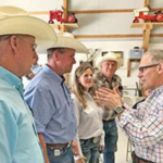 Pruitt (right) talks to KLA members (L to R) Mike Collinge, Hamilton; Joe Carpenter and KLA President Elect Barb Downey, Wamego; and Mike Holder, Cottonwood Falls. (Courtesy of KLA)