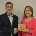 Dean Ron Rosati, congratulates Sandi Reinke Wendell. (Courtesy of NCTA)