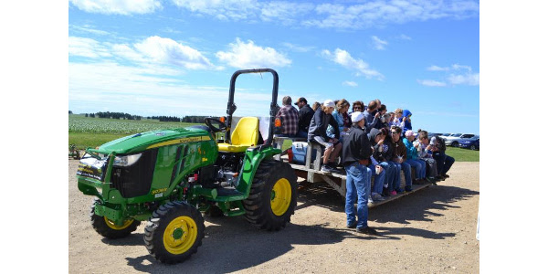 Guests taking a tour of MoDak dairy at the 2017 open house. (Courtesy of Ag United for South Dakota)
