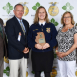 Pictured are West Carroll FFA Advisors Dan Hartman and Don Mathey with Emma Aljets and her parents, Deana and Korey Aljets at this year's Illinois State FFA Convention. Emma was the State FFA Ag Processing Proficiency winner. (Courtesy of WIU)