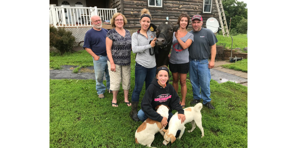 Kneeling with dogs: Shelby Dieball. Standing: Karl Dieball, Rosemary Dieball, Alyson Dieball, Wendy Dieball, Jim Dieball. (Courtesy of University of Minnesota Extension)