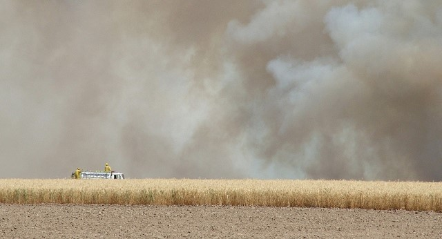 Farmers try to stop fire that's consuming crops