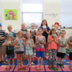 Stonington: Participants from Stonington Public Library showing off their terrariums and earth bracelets. (Courtesy of University of Illinois Extension)