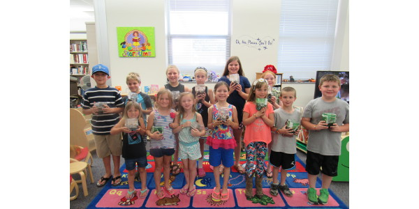 Stonington Participants From Public Library Showing Off Their Terrariums And Earth Bracelets